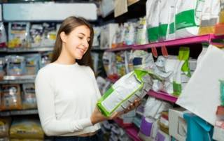 Woman buying pet food